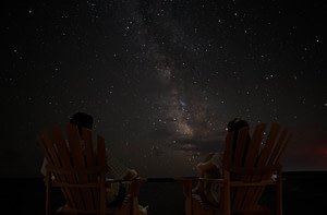 Couple enjoying a beautiful night sky